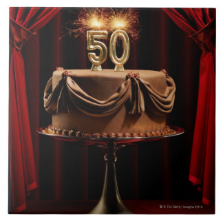 BIrthday Cake on Stage with number 50 candles Tile