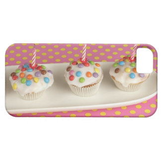 Birthday muffins with icing, sprinkles and iPhone 5 cover