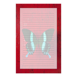 Black and blue butterfly on red wall stationery