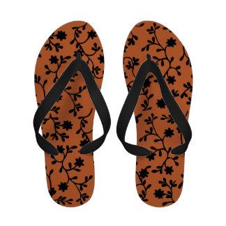 Black and orange vine flip flops