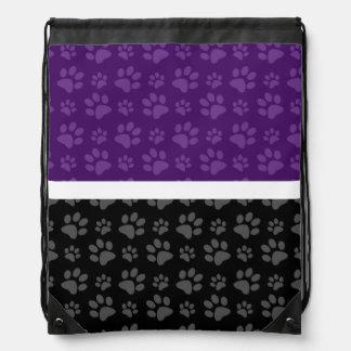 Black and purple dog paw print drawstring bag