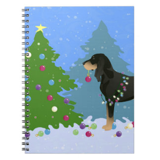 Black and Tan Coonhound Decorating Christmas Tree Notebook