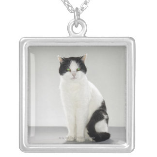 Black and white cat with glowing green eyes square pendant necklace