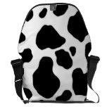 black and white cow print messenger bag