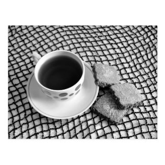 Black and white. Cup of tea and cookies postcard