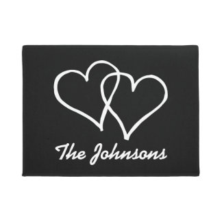 Black and white door mat with interlocked hearts