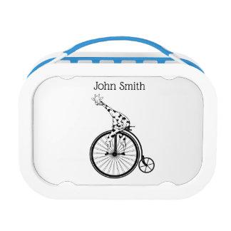 Black and white giraffe riding a bike lunch box