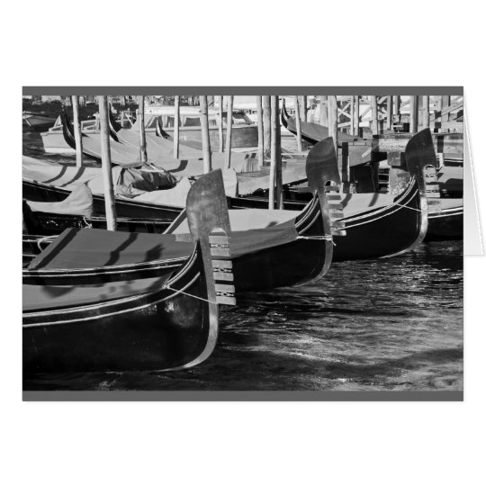 Black and white image of gondolas in Venice,