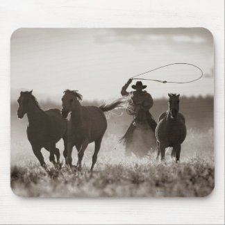 Black and White photo of a Cowboy Lassoing Horses Mouse Mat