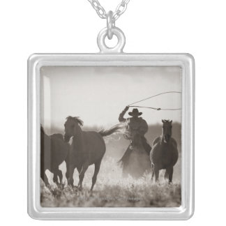 Black and White photo of a Cowboy Lassoing Horses Silver Plated Necklace