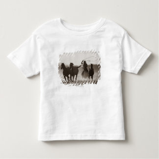 Black and White photo of a Cowboy Lassoing Horses Toddler T-Shirt