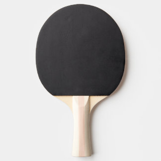 Black and white photograph of a spider and web ping pong paddle
