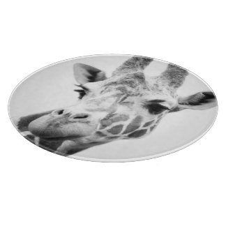 Black and white portrait of a giraffe cutting board