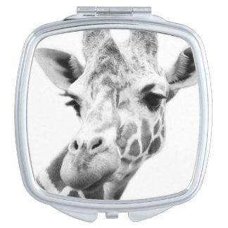 Black and white portrait of a giraffe travel mirrors