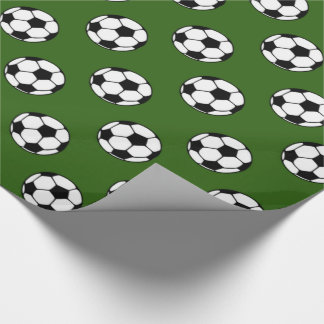 Black and White Soccer Balls on Green Wrapping Paper