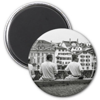 black and white three men face turning right 6 cm round magnet