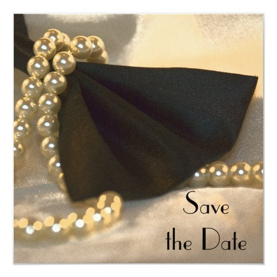 Black Bow Tie and White Pearls Save the