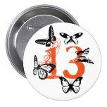 Black butterflies on orange '13' button. 7.5 cm round badge