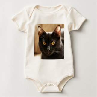 Black cat looking at camera eyes close up baby bodysuit
