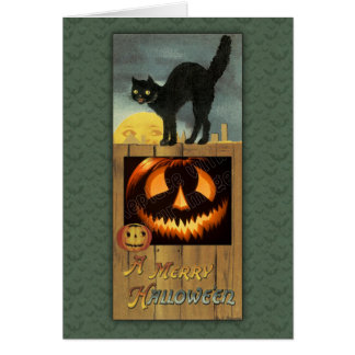 Black cat on a wooden fence with pumpkin greeting card