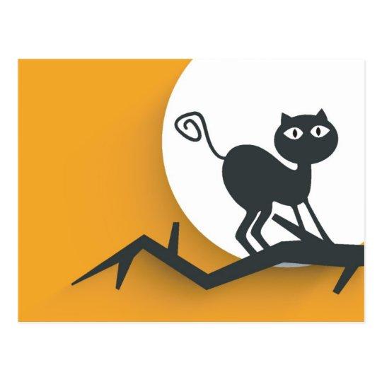Black cat on dead tree branch postcard