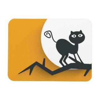 Black cat on dead tree branch rectangular photo magnet