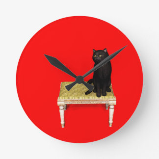 Black cat on the stool wall clock