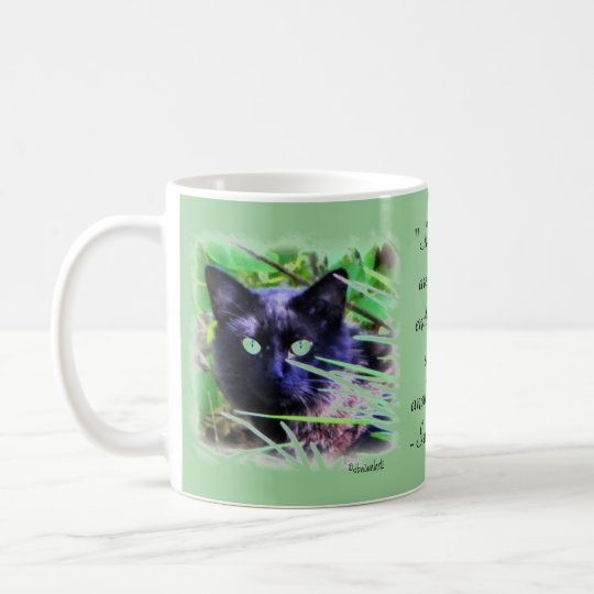 Black cat with striking green eyes coffee mug
