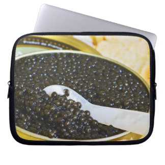 Black caviar and a spoon of mother-of-pearl to laptop sleeve