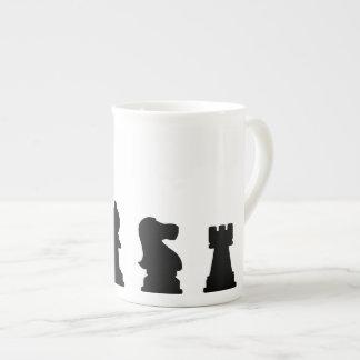Black chess pieces on white bone china mug