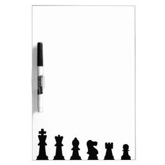Black chess pieces on white dry erase board
