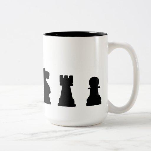 Black chess pieces on white coffee mug