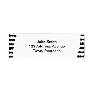 Black chess pieces on white return address label