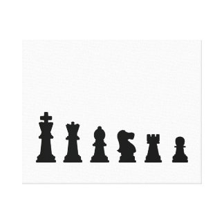 Black chess pieces on white stretched canvas print