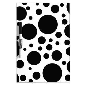 black dots on white dry erase board