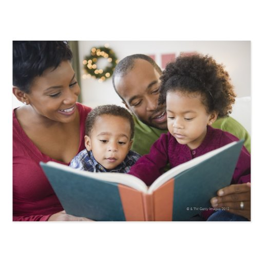 Black family reading book together post cards