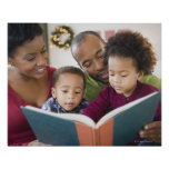 Black family reading book together poster
