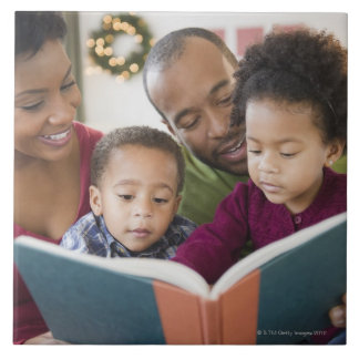Black family reading book together tile