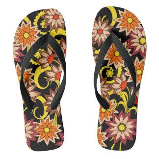 black floral pattern in boho style flip flops