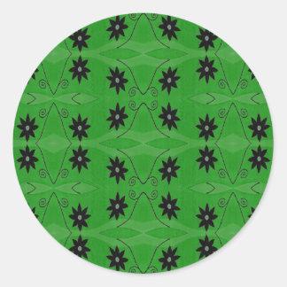black flowers on green round sticker