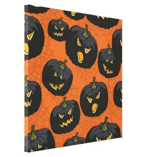 Black Halloween Pumpkins on Orange Stretched Canvas Print