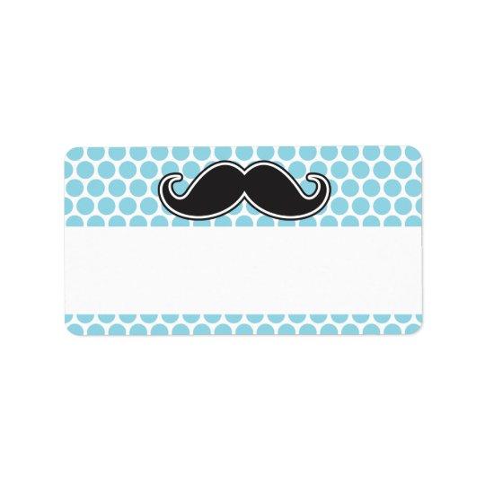 Black handlebar moustache on blue polka dot address label