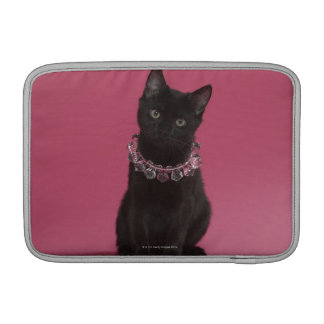 Black kitten wearing jeweled necklace MacBook sleeve