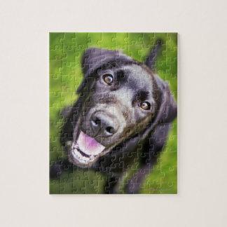 Black labrador puppy looking upwards, close-up jigsaw puzzle