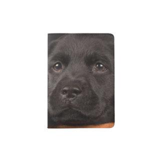 Black labrador retriever puppy in a basket passport holder