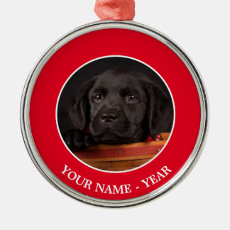 Black labrador retriever puppy in a basket Silver-Colored round decoration