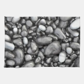 Black lava pebbles pattern tea towel