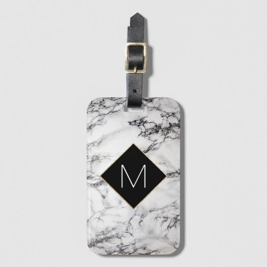 black monogram on faux white marble stone luggage