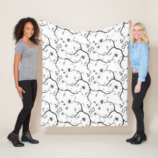 Black on white with branches, leaves and flowers fleece blanket