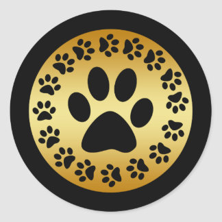 BLACK PAW PRINTS ON GOLD CLASSIC ROUND STICKER